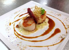 Our Coquilles Saint-Jacques has out-of-this-world flavor with plating inspired by our own galaxy: seared scallops, creamy leeks pancetta etouffee, olive oil saffron sauce