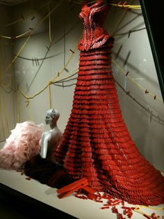 """www.retailstorewindows.com: Harvey Nichols, Hong Kong A dress created from Red coloured pegs, giant shoes comprised of CD's, a giant key and enormous teddy bear covered in dummy's (pacifiers to those of you reading this state side). """"pegs"""" are clothespins"""