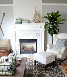 plank wood above fireplace. whitewashed brick. whitewashed hearth. two-tone wall paint.