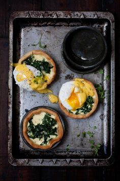 Creamy spinach breakfast tartlets topped with poached eggs and easy Hollandaise