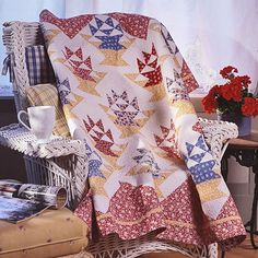 Red, blue, and yellow 1930s reproduction prints have as fresh a look today as they did back then. Combine those primary prints with the classic basket block for a timeless throw.
