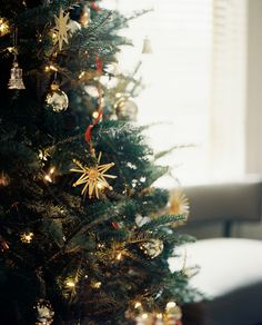 Holiday Decor Photo - A Christmas tree decorated with gold and silver ornaments