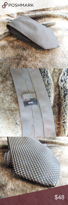 BOSS Hugo Boss tie - made in Italy Beautiful thick 100 % silk Made in Italy.  Tie is more like olive green base shade with flecks of orange and tan. Hugo Boss Accessories Ties
