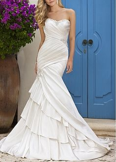 Fantastic  Mermaid Strapless Wedding Dress.. this is pretty.... but not the sheath style I'm looking for right now..