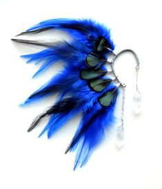 This beautiful feather ear cuff was made using royal blue feathers and rough quartz stones. This ear cuff is ready to be shipped. Perfect for non pierced