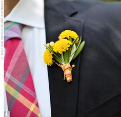 To go with their cheery madras-plaid ties, the guys wore equally sunny button mums on their lapels. The hearty flowers were chosen because they stand up well to the summer heat.