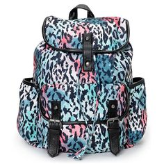 Make sure you are ready for Back to School or your next road trip with a touch of wild flavor with the Empyre Girl Emily leopard print rucksack backpack for girls. This bag comes in a White, Turquoise and Coral colorway with Black animal print throughout, and features a fully lined main compartment, two open side pockets, and a front flap pocket for your small stuff. With a drawstring cinch closure, magnetic snaps, and Black PU trims, the Emily Empyre backpack has a dangerously good look…