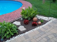Garden, mulch beds, mulch washing away, drainage solution for patio