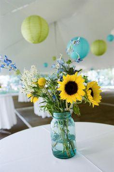 blue mason jars with sunflowers