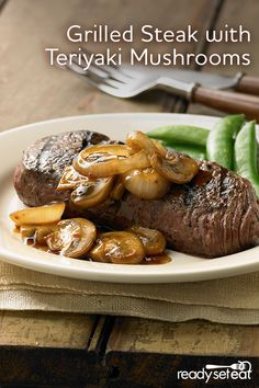 Swoon your special someone with this grilled steak with teriyaki mushrooms recipe. Rich flavors of caramelized onions and tender mushrooms are combined in a teriyaki stir fry sauce topped on a perfectly cooked sirloin steak!
