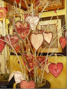 cardboard cereal box hearts decorated and hung on twig tree- do like the gratitude tree in groups