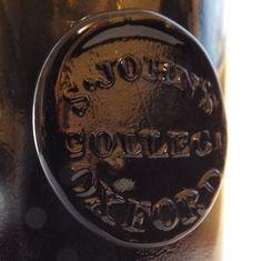 Antique Bottles 410 - December - Internet Auction - St. John's College Oxford sealed wine bottle, c1840.