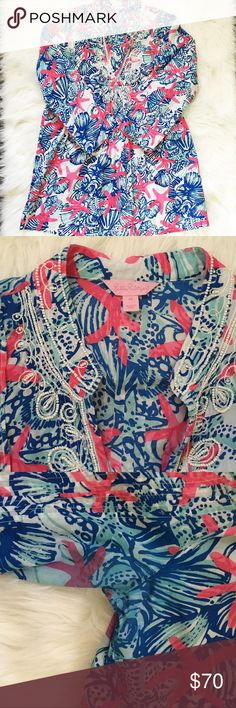 """Lilly Pulitzer She She Shells Sarasota Tunic Beautiful sarasota tunic shirt by Lilly Pulitzer in print she she shells, starfish and seashells. Size M. There is color bleeding on both underarms but when worn isn't very noticeable, I bought this off of Posh and unfortunately the seller didn't disclose this. The beading and everything else is in excellent condition! 100% cotton, total length is approx 30"""", armpit to armpit when laid flat is approx 20.5""""  No trades or modeling 🚫 Smoke free but…"""