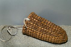 The Ohlone Indians of California traditionally used woven baskets made from tule reeds with a leather strap for the gathering of foods and m...