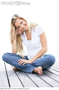 woman sitting crossing legs