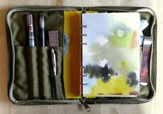 sketch kit.  Honestly.. I need to look into Day Planners that zip around like this wooooooooo