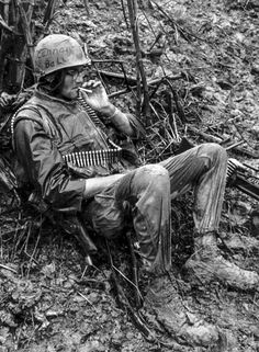 "peerintothepast: "" A machine gunner with the 7th Marines takes a break during Operation Meade River near the city of Da Nang, November 1968. (LCPL R. Sanville/Marine Corps/National Archives) """