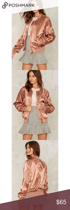 Rose Gold Satin Bomber Jacket *As seen on Nasty Gal - label does not say nasty gal but from same manufacturer* Keep runnin' around. The Let it Satin Jacket comes in mauve satin and features a classic bomber jacket silhouette, ribbed hem at bottom and cuff, high neckline, full lining, utility pocket at sleeve, and front waist pockets.  *Body  97% Polyester  3% Spandex  *Contrast  95% Polyester  5% Spandex  *Lining  100% Polyester  *Hand wash cold  *Imported Nasty Gal Jackets & Coats