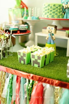 Cute popcorn boxes at a Minecraft Party with So Many Awesome Ideas via Kara's Party Ideas Kara Allen KarasPartyIdeas.com #VideoGameParty #MinecraftParty #BoyParty #PartyIdeas #PartySupplies