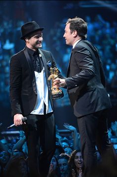 Jimmy Fallon moves in to hug his buddy Justin Timberlake and deliver his Video Vanguard award at the 2013 MTV Video Music Awards in Brooklyn, New York. | MTV Photo Gallery