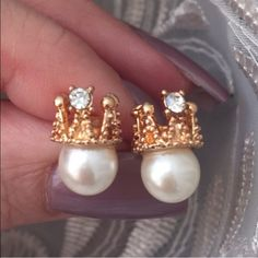 2/$15 Crown & Faux Pearl Earrings Rhinestone accented golden crown sits atop faux pearl. Post earrings for pierced ears. Brand new and unworn. Fashion/costume jewelry. No trades, no holding, no offsite payment.     All $9 earrings are two pairs for $15.     ❗️PRICES ARE FIRM UNLESS BUNDLED❗️ Jewelry Earrings