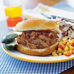 Slow-Cooker Pulled Pork | This slow-cooker pulled pork recipe makes budget-friendly homemade barbecue a breeze! 7 ingredients and 10 minutes of prep time are all you need to get this dish cooking for dinnertime. For delicious barbecue sandwiches, add honey, barbecue sauce, mustard, and soy sauce to the slow cooker when the meat is done and cook for an additional hour on low. Serve on hamburger buns with a side of baked beans, macaroni and cheese, coleslaw, and cornbread for the ultimate…