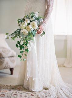 Elegant cascading white bouquet: http://www.stylemepretty.com/2015/10/08/black-white-dos-pueblos-ranch-wedding/ | Photography: Jose Villa - http://josevilla.com/