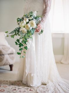 Elegant cascading white bouquet: http://www.stylemepretty.com/2015/10/08/black-white-dos-pueblos-ranch-wedding/ | Photography: Jose Villa - http://josevilla.com/