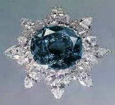 This photo of the Wittelsbach Blue was taken by Ernst Albrecht Heiniger and his wife Jeanne after years spent tracking down the diamond. The mounting was created in the 1960s by Harry Winston and was designed to reduce the visibility of the extremely large culet, and thus improve the overall appearance of the historic stone.