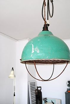 turquoise industrial lamp.... IDK what this pin is I didn't open bit but it makes me think of up cycling an old grill in a retro paint and Edison bulb