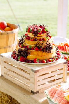 Rustic strawberry covered naked cake: http://www.stylemepretty.com/canada-weddings/ontario/2014/12/18/backyard-autumn-engagement-party/ | Photography: Redeemed: http://redeemedphotography.weebly.com/