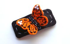 monarch butterfly orange and black hair clip. via Etsy.