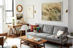 The Brooklyn home of Cup of Jo has many of the hallmarks of Scandi style: gray sofa, black-and-white blanket, mid-century modern classics, IKEA pieces, pops of color (the pillows are reminiscent of Finnish Marimekko designs), and plenty of wood and white.