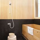 A Japanese hinoki bowl and stool from Mjölk sit next to a custom hinoki bathtub by Bartok Design in the tub room.   Photo by Derek Shapto...