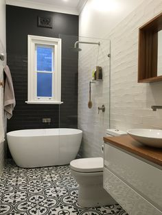 Our new bathroom renovation! Kalafrana Ceramics patterned encaustic replica glazed tiles and the Early Industry satin white and charcoal subway tiles. Timberline vanity with recycled blackbutt top and mirror.