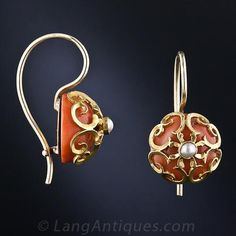 A pair of orangy coral half-beads reside in 18 karat golden cages, crowned with a shimmering seed pearl in these rather unusual and extra-delightful Victorian-era earrings on simple ear wires. 7/16 inch diameter.
