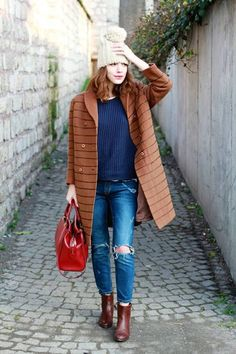Shop this look on Lookastic:  http://lookastic.com/women/looks/beanie-crew-neck-sweater-coat-skinny-jeans-tote-bag-ankle-boots/7828  — Beige Beanie  — Navy Crew-neck Sweater  — Tobacco Coat  — Navy Ripped Skinny Jeans  — Red Leather Tote Bag  — Burgundy Leather Ankle Boots