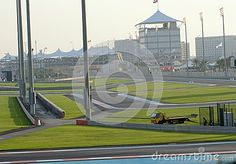 Yas Circuit Trackside Terrace building and Pavillions overlooking the race track, with flag of United Arab Emirates