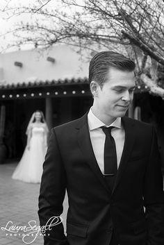 Groom waits for his bride during their first look at the Desert Botanical Garden. http://www.segallphotography.com/blog/2015/03/nicolette-and-codys-desert-botanical-garden-wedding/
