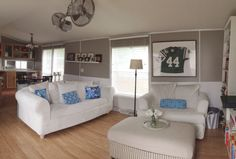 Single wide manufactured mobile home remodel makeover living room great room open concept  Smoked oyster by Valspar on the walls. Minka Aire Gyro ceiling fan.