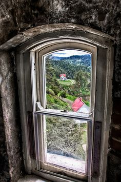 Window..look at this view! Looks like a view from Heceta Head lighthouse in Oregon.