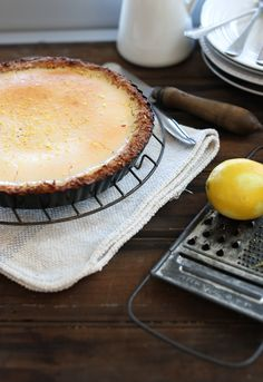 Lemon & coconut tart. Gluten free, dairy free & sugar free. This is super delicious & easy to make. Recipe in cookbook Real Food Pledge.