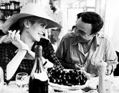 Catherine Deneuve and Gene Kelly photographed during a lunch break on the set of The Young Girls of Rochefort, 1967.