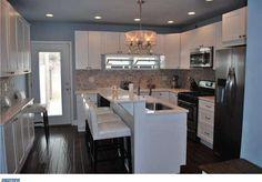 Traditional Kitchen with U-shaped, Flush, Breakfast bar, Limestone counters…