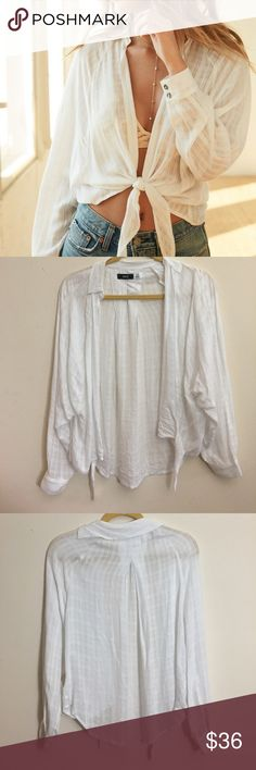 Bdg Courtney tie-front white blouse Medium Bought from Urban Outfitters. Currently on the UO website for $59 but I need to clean out my closet fast so I'm listing for much less. Worn once for a photoshoot. In PRISTINE condition. Pet free and smoke free home! Reasonable offers will be accepted! ✨ Urban Outfitters Tops Blouses