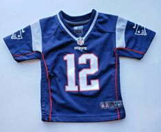 NFL Patriots Brady Football Jersey by Nike Navy Blue Youth Patriots Team, New England Patriots Football, Youth Football Jerseys, Nfl Jerseys, Lion Shirt, Custom Football, Nfl Team Apparel, Patriotic Shirts, Tom Brady