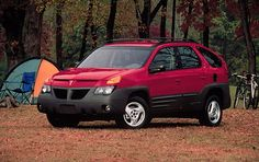 2001 Pontiac Aztek. On the internet there are many opinions about the ugliest car of all time. The Aztek usually makes the list. Doesn't look that bad to me. In fact, it looks like many of the station wagon/SUV hybrids being built today.