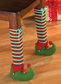 Super cute Elf chair leg covers. The kids would get a kick out of this at a Christmas party!