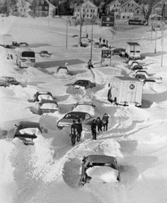 Stranded motorists walk in between their cars on I-95 in Pawtucket, R.I. in this Feb. 7, 1978 file photo, the day after the worst blizzard in southern New England history. The storm was blamed for 21 deaths in Rhode Island with an estimated 30,000 stranded motorist throughout the State. Over 28 inches of snow was recorded at T.F. Green Airport in Warwick, R.I., while over 55 inches was recorded in Woonsocket, R.I