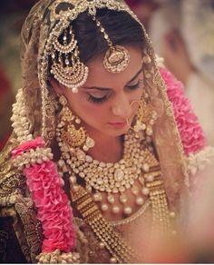 Heavy Gold and Diamond Jewelry on a Punjabi Bride